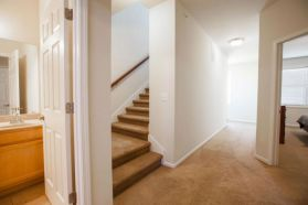 Grand Champions - Furnished townhome hallway stairs