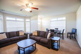 Grand Champions - Furnished townhome living room and dining area