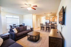 Grand Champions - Furnished townhome living room and kitchen